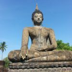 Big Buddha, little Buddha: once it was golden. Now he's pink